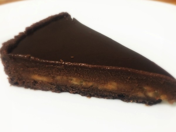 Slice of chocolate and banana tart